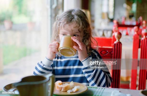 Girl having breakfast in a cafe England