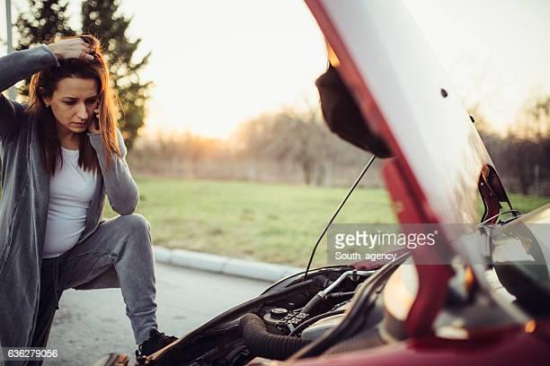 Girl having car problems