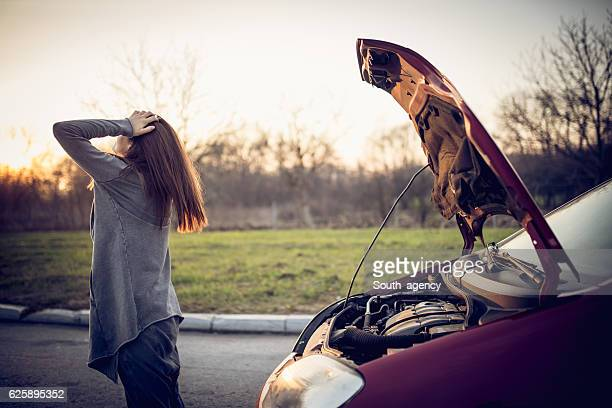 Girl having car trouble