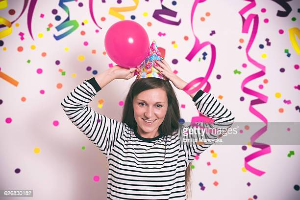 girl having fun at a birthday party - streamer stock photos and pictures