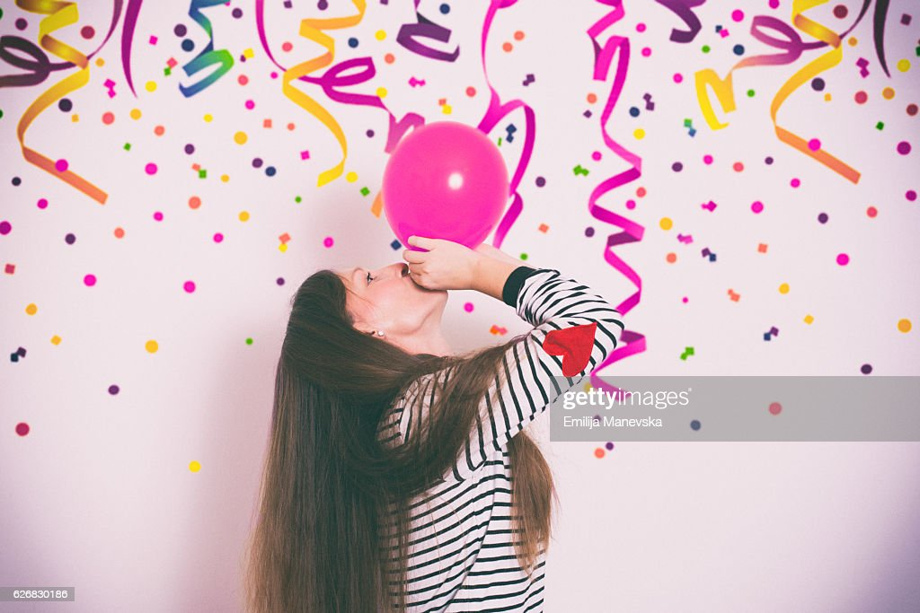Girl having fun at a birthday party : Stock Photo