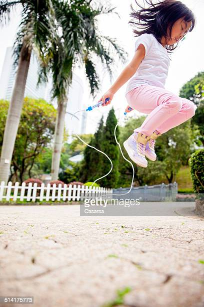 Girl having fun in the city park