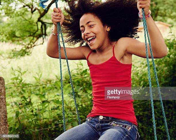 girl having fun on a swing - childhood stock pictures, royalty-free photos & images