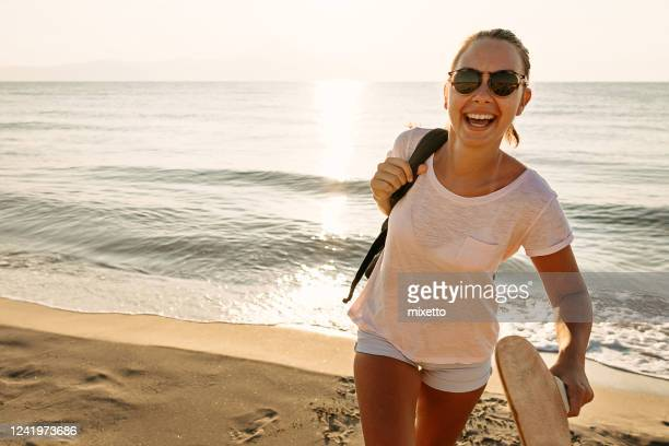 girl having fun on beach - only teenage girls stock pictures, royalty-free photos & images