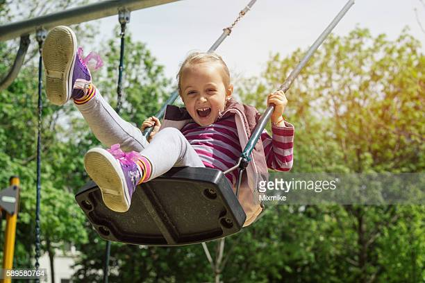 girl having fun on swing - swinging stock pictures, royalty-free photos & images