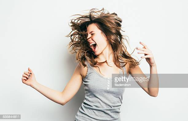 girl having fun - opwinding stockfoto's en -beelden