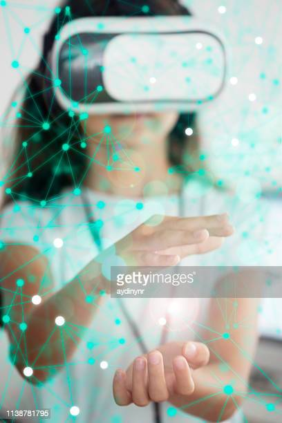Girl having fun with VR headset