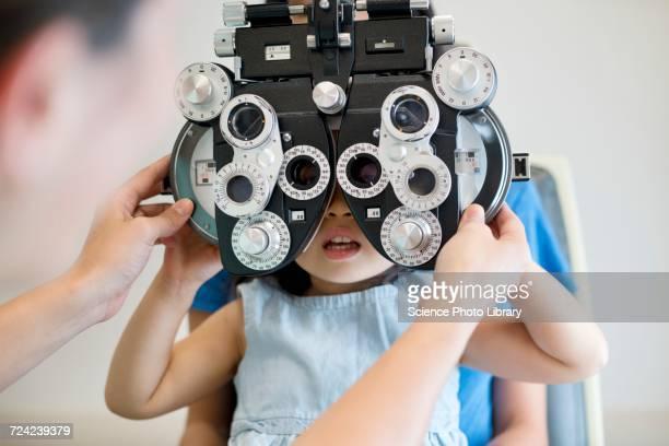 Girl having her eyes tested