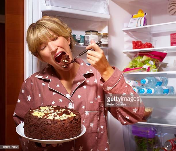girl having midnight feast - bulimia fotografías e imágenes de stock