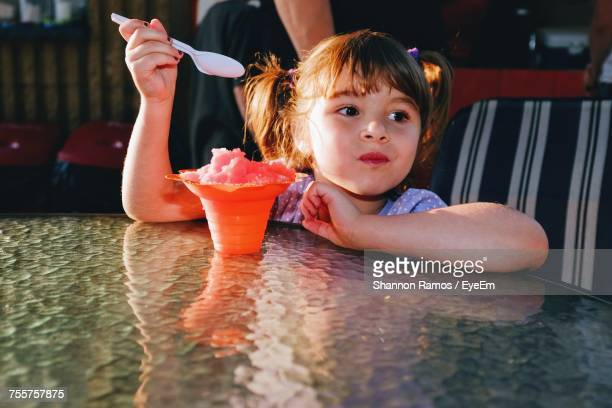 Girl Having Shave Ice At Table