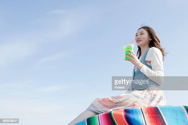 Girl having soda on table