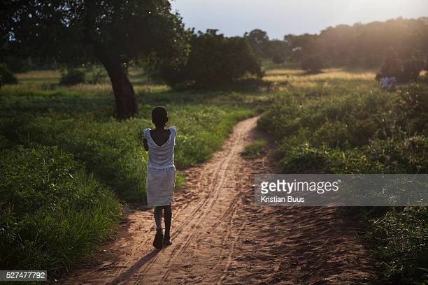 A girl heads home in the dying light in the evening in rural Makurdi in Benue State NigeriaBenue state has got one of the highest HIV prevalence in...