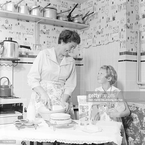 A girl helping her mother to make a cake Chelmsford Essex 12th August 1960