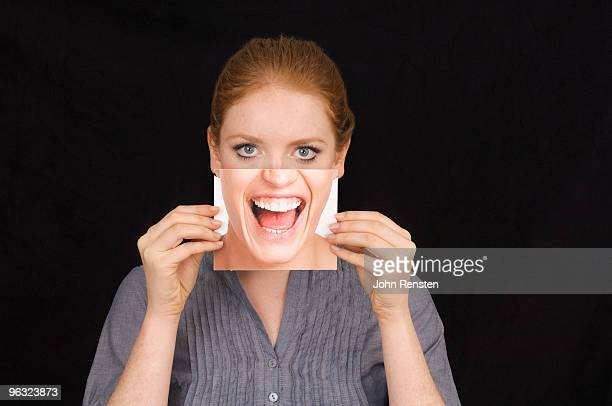 girl hiding behind  mask with happy shouting face