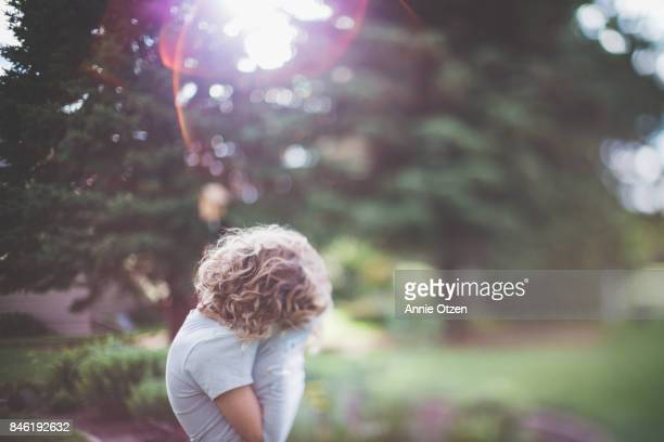 girl hiding face - obscured face stock photos and pictures