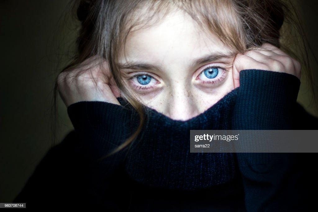 Girl hiding her face. : Stock Photo