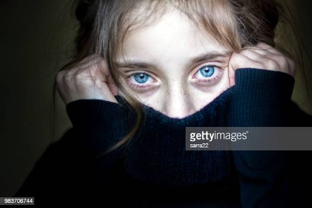 girl hiding her face. - scary face stock photos and pictures
