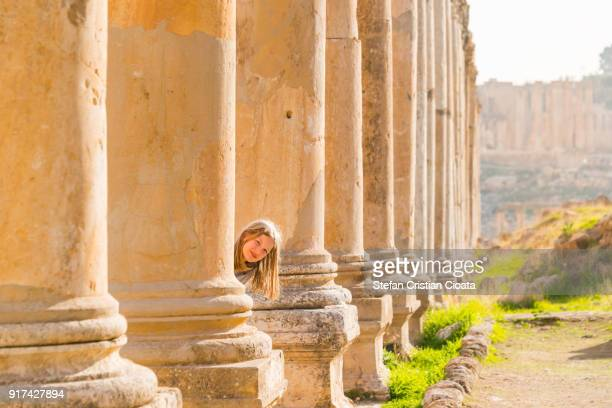 Girl hiding in Jerash Roman city