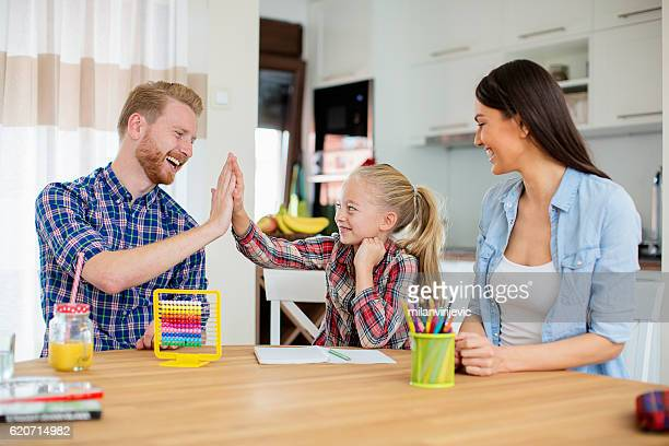 girl high-fiving her dad - homeschool stock photos and pictures