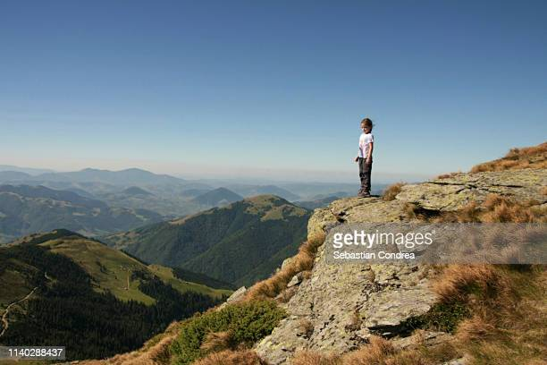 girl hiker on rocky mountain summit overlooking peak panorama. - country geographic area stock pictures, royalty-free photos & images
