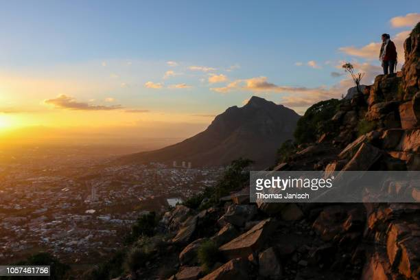 Girl hiking up Lion's Head during sunrise, Cape Town, South Africa