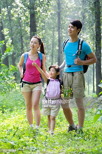 Girl hiking with her parents