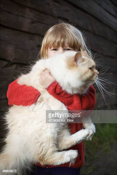 Girl holding a big cat, Sweden.