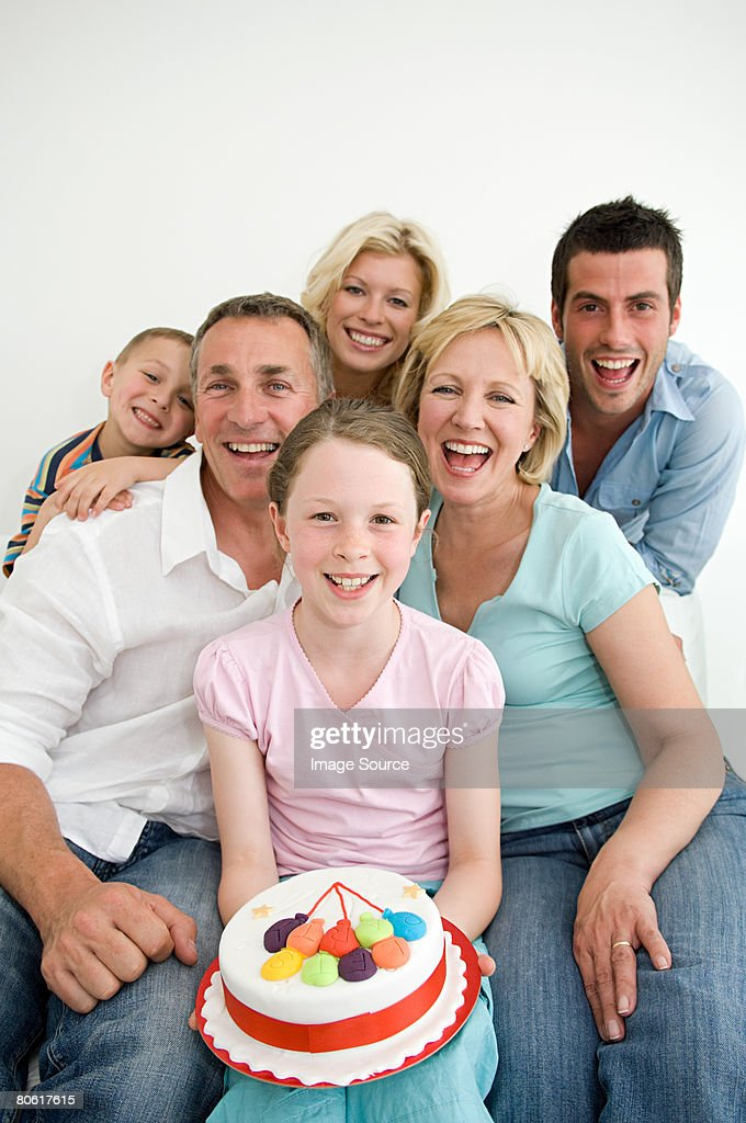 Fine Girl Holding A Birthday Cake Surrounded By Family High Res Stock Funny Birthday Cards Online Bapapcheapnameinfo