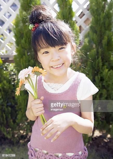 Girl Holding a Bouquet Flowers