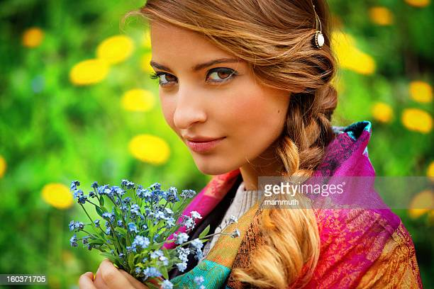 girl holding a bouquet of wild flowers