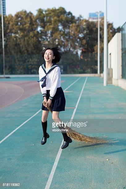 girl holding a broom