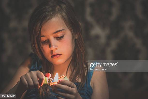 girl holding a candle - cigarette lighter stock pictures, royalty-free photos & images