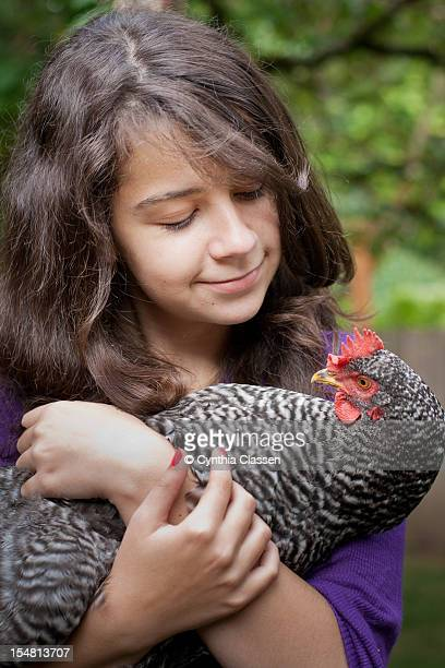 Girl (13) Holding a Chicken