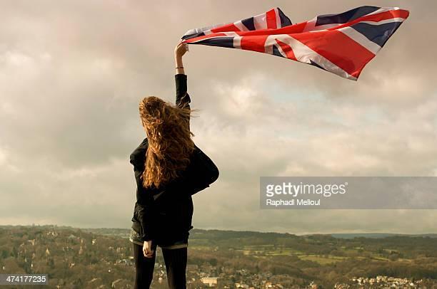 CONTENT] Girl holding a flag over Bradford England