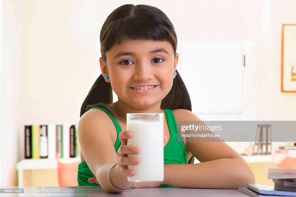 Girl holding a glass of milk : Stock Photo