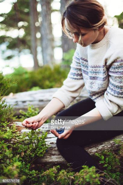 Girl holding a handful of blueberries