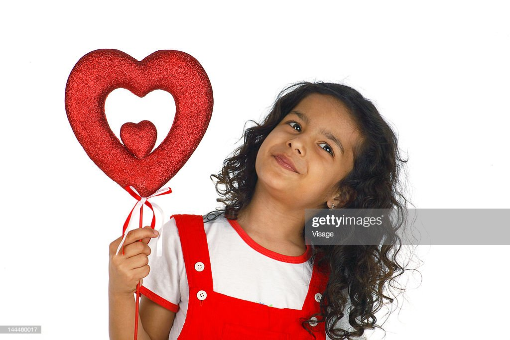 Girl Holding A Heart Shaped Thermocol Art Stock Photo