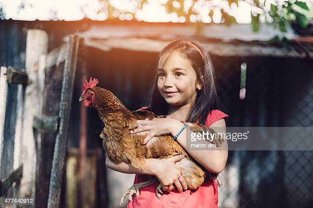 Mädchen holding eine hen