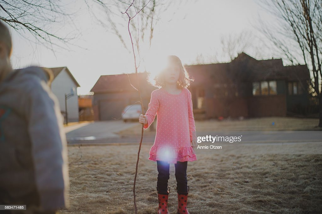 Girl Holding a Large Stick : Stock Photo