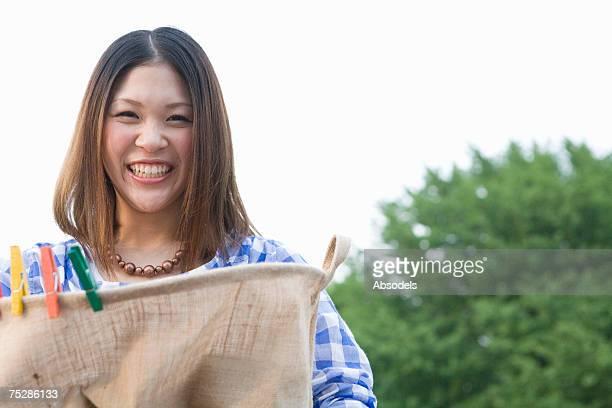 A girl holding a linen basket