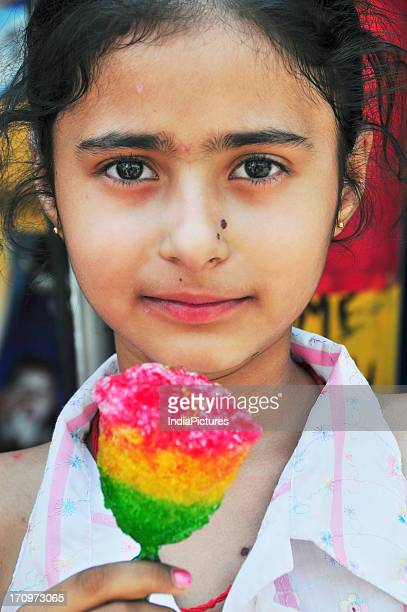Girl holding a lolly stick Amritsar Punjab India
