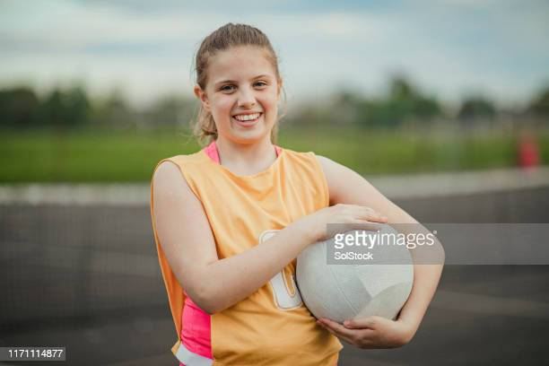 girl holding a netball - sport venue stock pictures, royalty-free photos & images