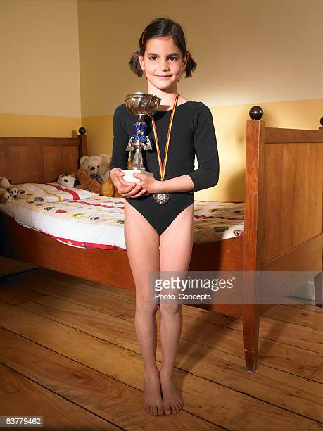 girl holding a trophy - little girls doing gymnastics stock photos and pictures