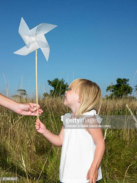 girl holding a wind-driven - kin in de hand stock pictures, royalty-free photos & images