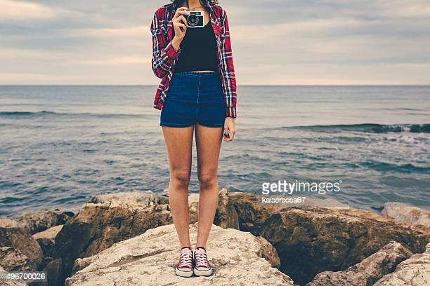 Girl holding an analog film camera