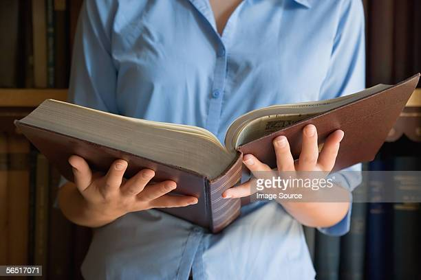 Girl holding an old book