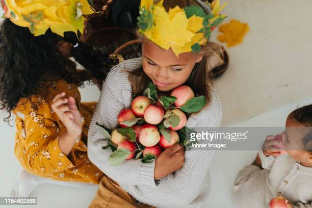 girl holding apples - young girl breasts stock pictures, royalty-free photos & images