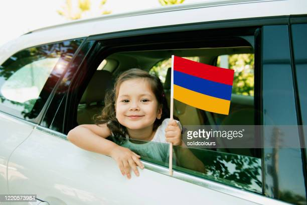 girl holding armenian flag - armenian flag stock pictures, royalty-free photos & images