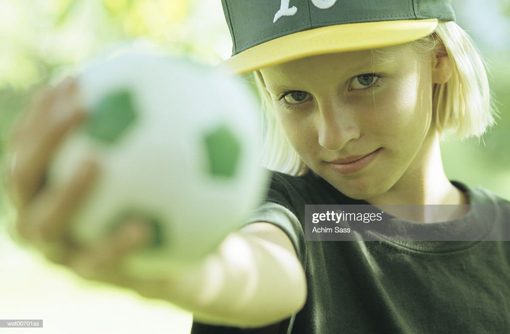 Girl holding ball : Foto stock
