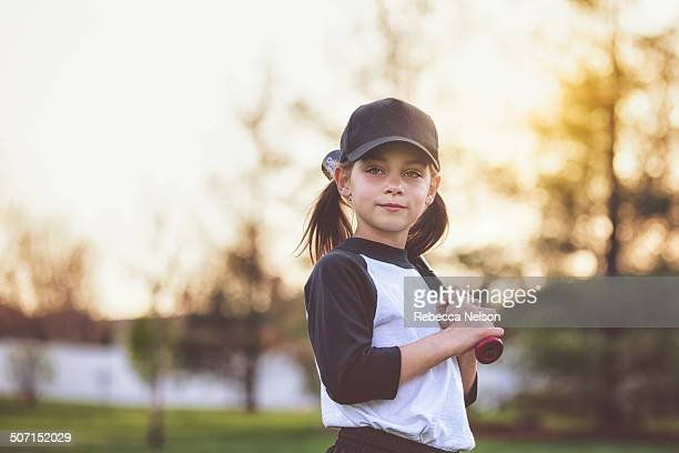 girl holding baseball bat - baseball sport stock pictures, royalty-free photos & images